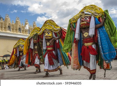 Performers walking in the streets of Mysore during procession at Dasara. Mysore, Karnataka, India.