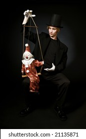 Performing artist with clown marionette