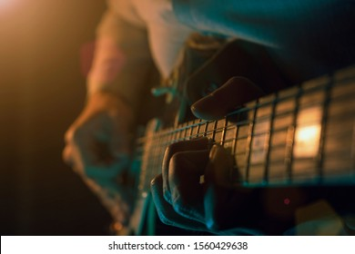 Performing a guitar melody from the stage