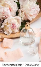 perfume bottle with flowers. peony, woman perfume