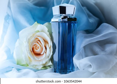 perfume bottle on a blue background