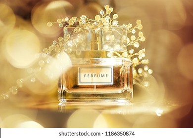 Perfume bottle on golden bokeh background. Aromatic Eau de Toilette