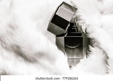 Perfume Bottle on White fur texture background