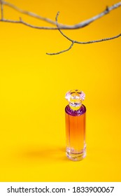 Perfume bottle on a yellow background. Copy space, layout, background