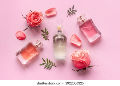 Perfume bottle with peonies and roses flowers