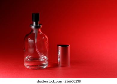 perfume bottle with red background