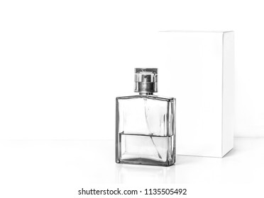 Perfume bottle, transparent glass sprayer and white packaging box mockup