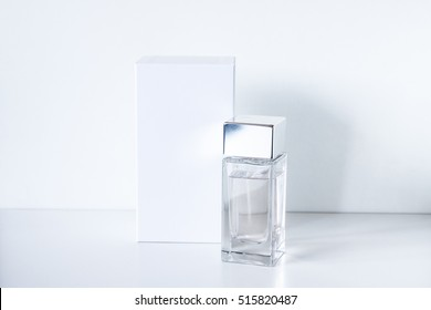 Perfume bottle and white gift box mock up