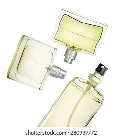 Perfume bottles floating against white background. Clipping path