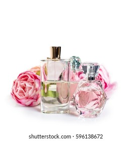 Perfume bottles with flowers on light background. Perfumery, cosmetics, fragrance collection.
