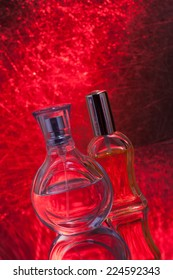 Perfume bottles isolated on red background