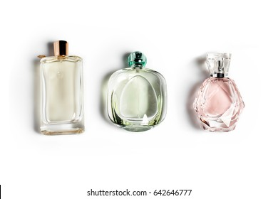 Perfume bottles on light background. Perfumery, cosmetics, fragrance collection.