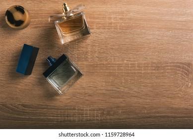 Perfume bottles on wooden background.
