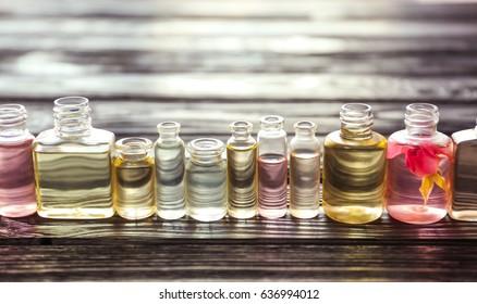 Perfume bottles on wooden table