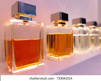 Perfume bottles in a row on a shelf