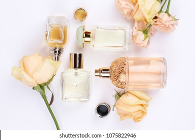 perfume bottles surrounded by flower