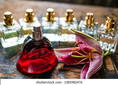 Perfume bottles surrounded by flower. eau de toilette. eau de parfum. Parfum with flowers.