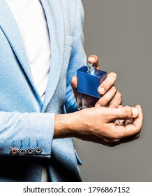 Perfume or cologne bottle. Male fragrance and perfumery, cosmetics. Man perfume, fragrance. Masculine perfume. Man holding up bottle of perfume. - Shutterstock ID 1796867152