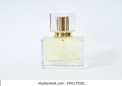 perfume or eau de toilette in square glass bottle isolated on white background