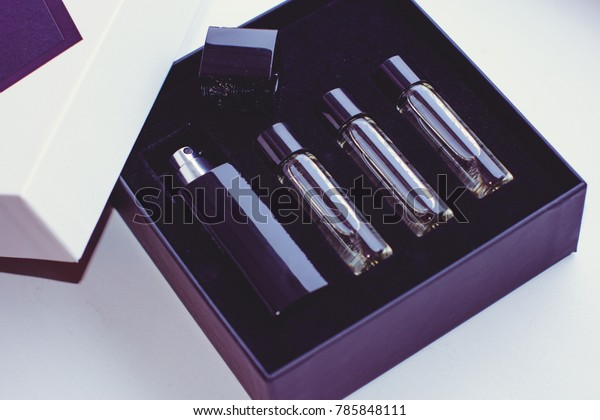 Perfume in a gift box in small travel cases. Niche Unisex Perfume