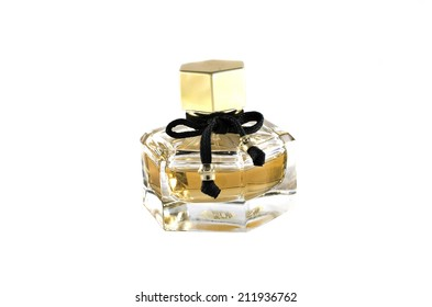 perfume in glass bottle on white background