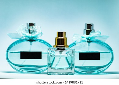 Perfume glass bottles various color set on white background. Eau de toilette. Eau de parfum. Beautiful composition of perfume bottles.