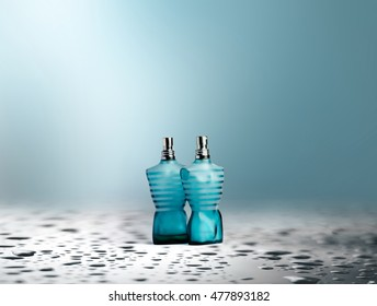 Perfume on abstract blue background