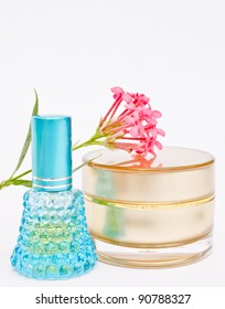 perfume and powder with flower on white background