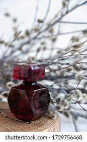 perfume in a ruby bottle
