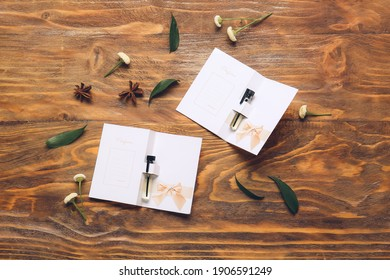 Perfume samples on wooden background