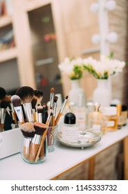 Perfumery and cosmetics on a dressing table with a mirror