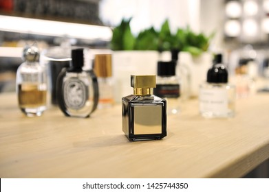 A lot of perfumes for all seasons. Summer, spring, autumn, winter bottles for all perfumer lovers. Fragrance workshop banner. Copy space, design space. Niche perfume.