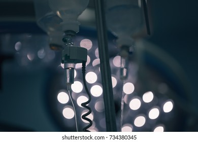 perfusion drip equipment hanging in hospital medical unit, blue background