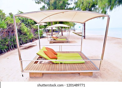 Pergola on beach with withe sand in front of the Sea view