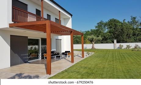 Pergola over terrace and home garden