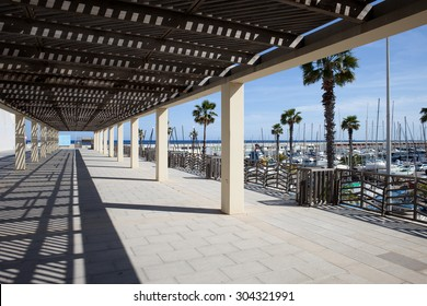 Pergola shaded passageway at Port Olympic in Barcelona, Catalonia, Spain.