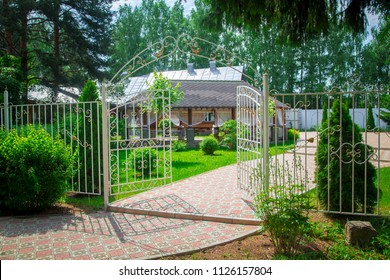 Pergola with terrace and metal fence