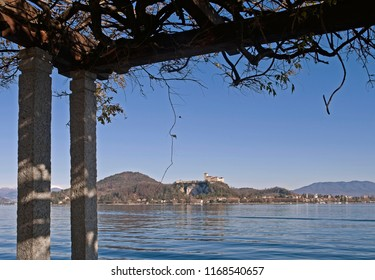 pergola and the town of Angera in the background, Lake Maggiore, Italy