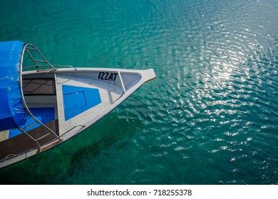 PERHENTIAN KECIL ISLAND, TERENGGANU, MALAYSIA - MARCH, 2017: A boat and fishes under clear sea water