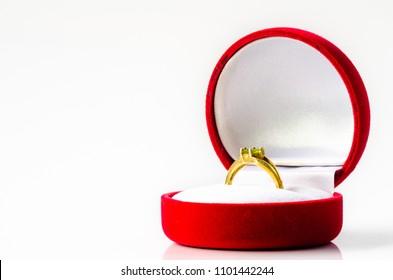 Peridot gold ring on red velvet box White background ,  For people born Leo.