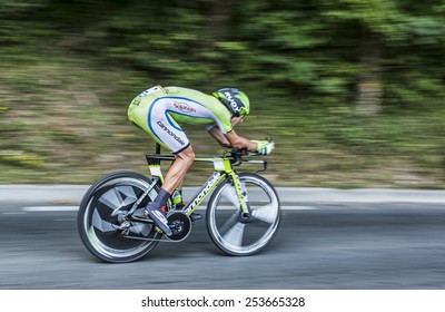 PERIGEUX,FRANCE-JUL 26: Panning image of the Polish cyclist Maciej Bodnar  (CannondaleTeam) pedaling during the stage 20 ( time trial Bergerac - Perigueux) of Le Tour de France 2014.