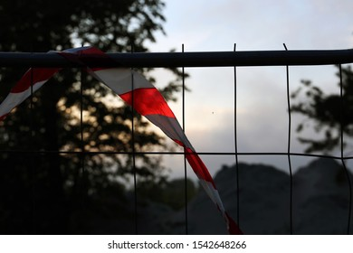 Perimeter tape stuck on a fence