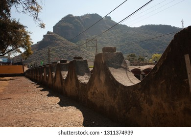 Perimeter wall of arches that surrounds the former convent of San Juan Bautista in a magical town in a state of Mexico