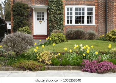 A period house in Pinner, London, with a front garden planted with daffodil flowers