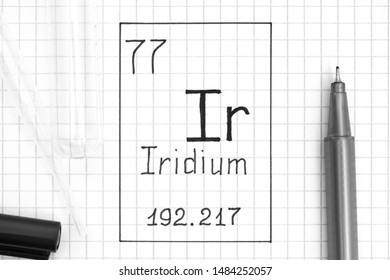 The Periodic table of elements. Handwriting chemical element Iridium Ir with black pen, test tube and pipette. Close-up.