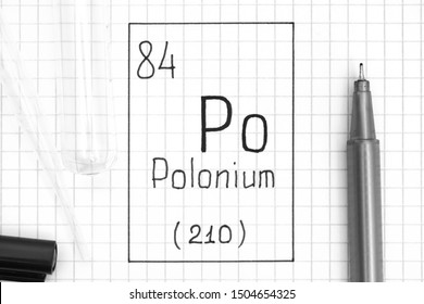 The Periodic table of elements. Handwriting chemical element Polonium Po with black pen, test tube and pipette. Close-up.