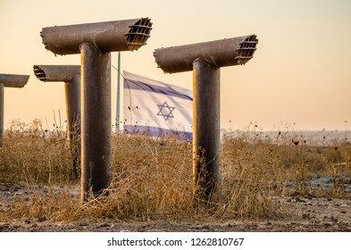 Periscopes frame the Israeli flag flying above the fortifications at Tel Saki in Israel's Golan Heights, site of the Yom Kippur War of 1973