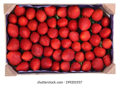 Perishable food, a wooden pallet with red fruits strawberries, isolated image on white background.