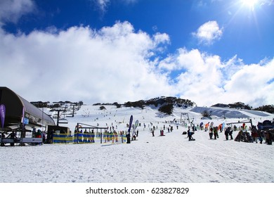 Perisher Ski Resort,Sydney Australia:Monday 1st August 2016:Skiers and snowboarders on a ski slope in resort on snowy winter background. Perisher Ski resort in winter in fine weather.