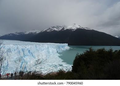 perito moreno glacier view in rainy day with snowed mountais, Calafate, Argentina